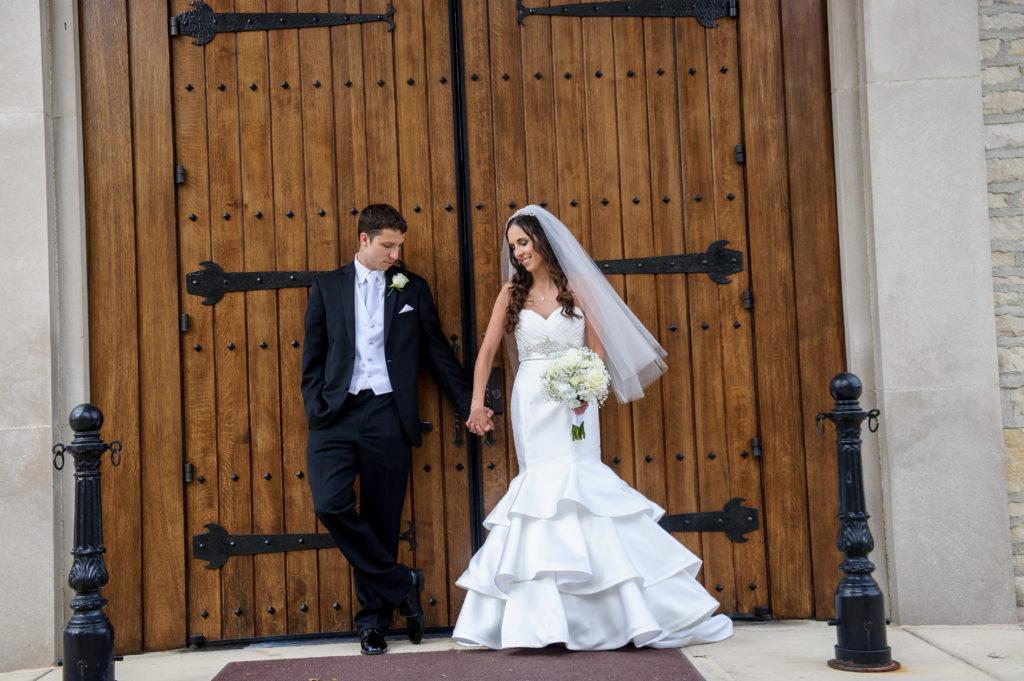 Julie & Chris on wooden door