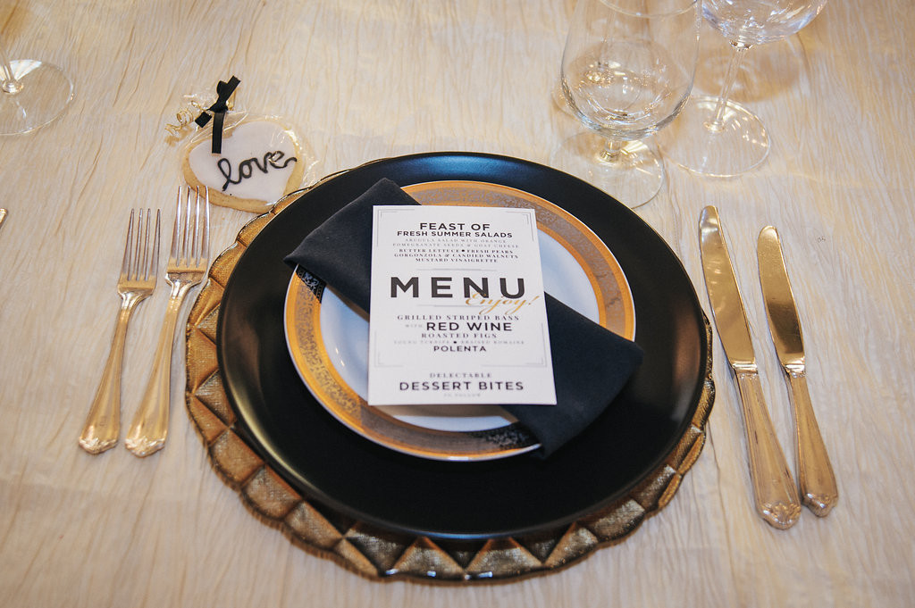 Table setting with black napkin and menu