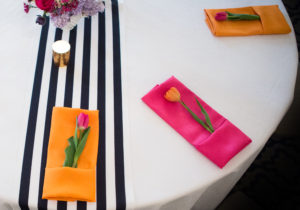 Black and white table runner- orange and pink napkins
