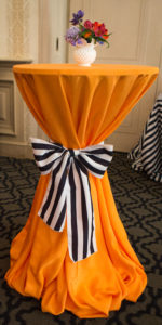 Orange cocktail table-black and white tie