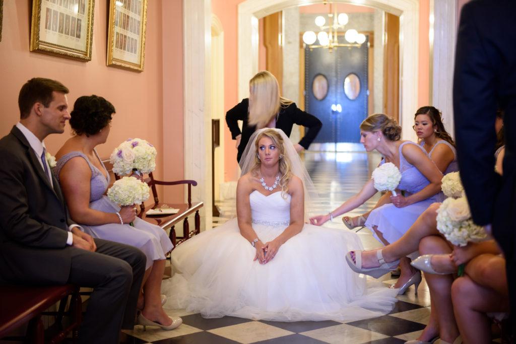 Bride sitting on floor