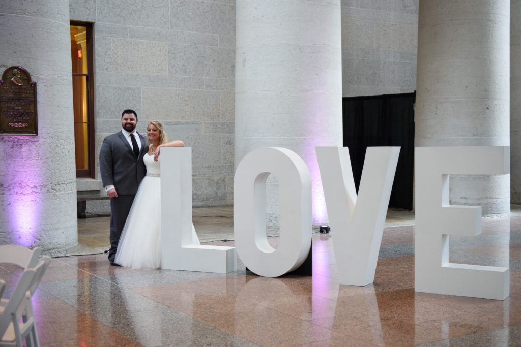 Bride and Groom with love sign