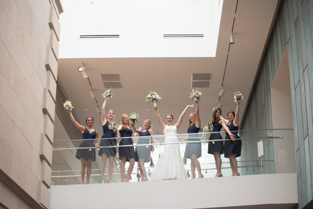 Bridal party navy dresses with bouquets
