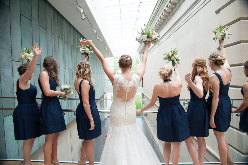 Bridal party with bouquets and navy dresses