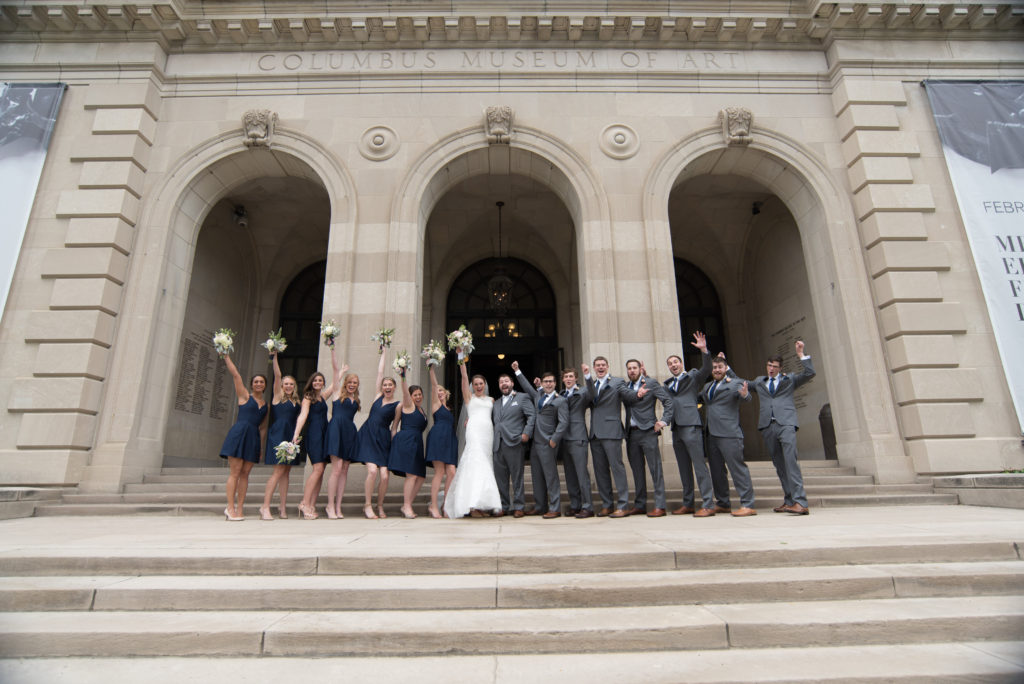 Wedding party navy dresses gray suits