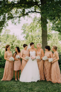 Bridal party with pink gold dresses