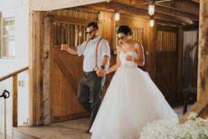Bride and groom reception entrance with sunglasses