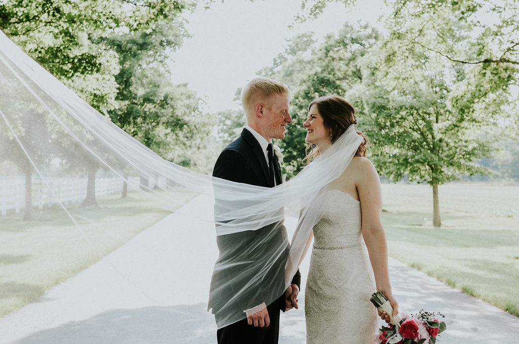 Bride and groom with long veil