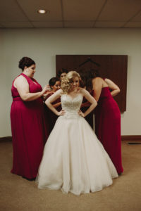 Getting ready, wedding dress, berry bridesmaid dress