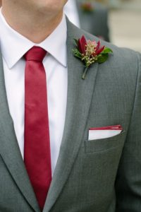 groom red tie