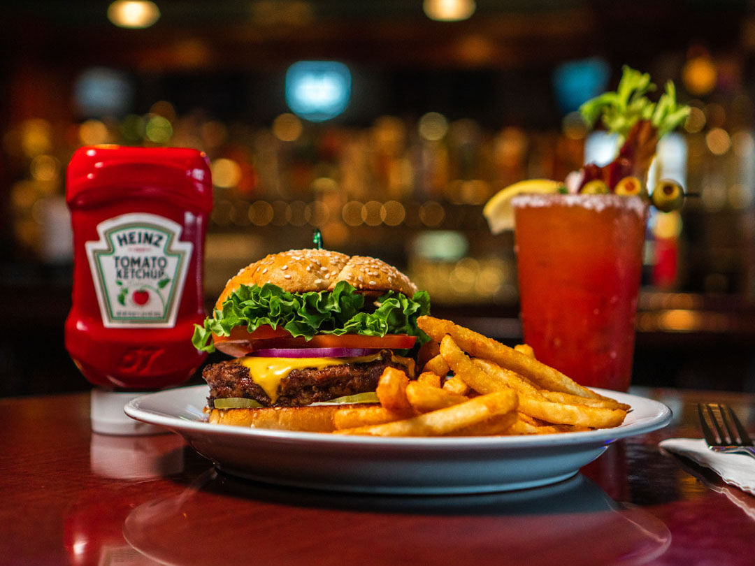 Burger and Fries, with a Bloody Mary in the background