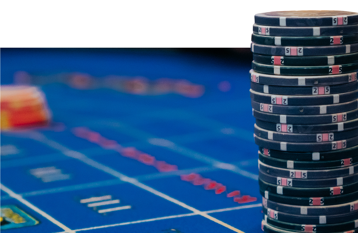 a stack of chips on a blue felted casino table