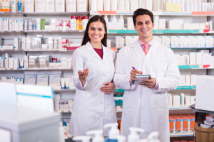 two pharmacists smiling