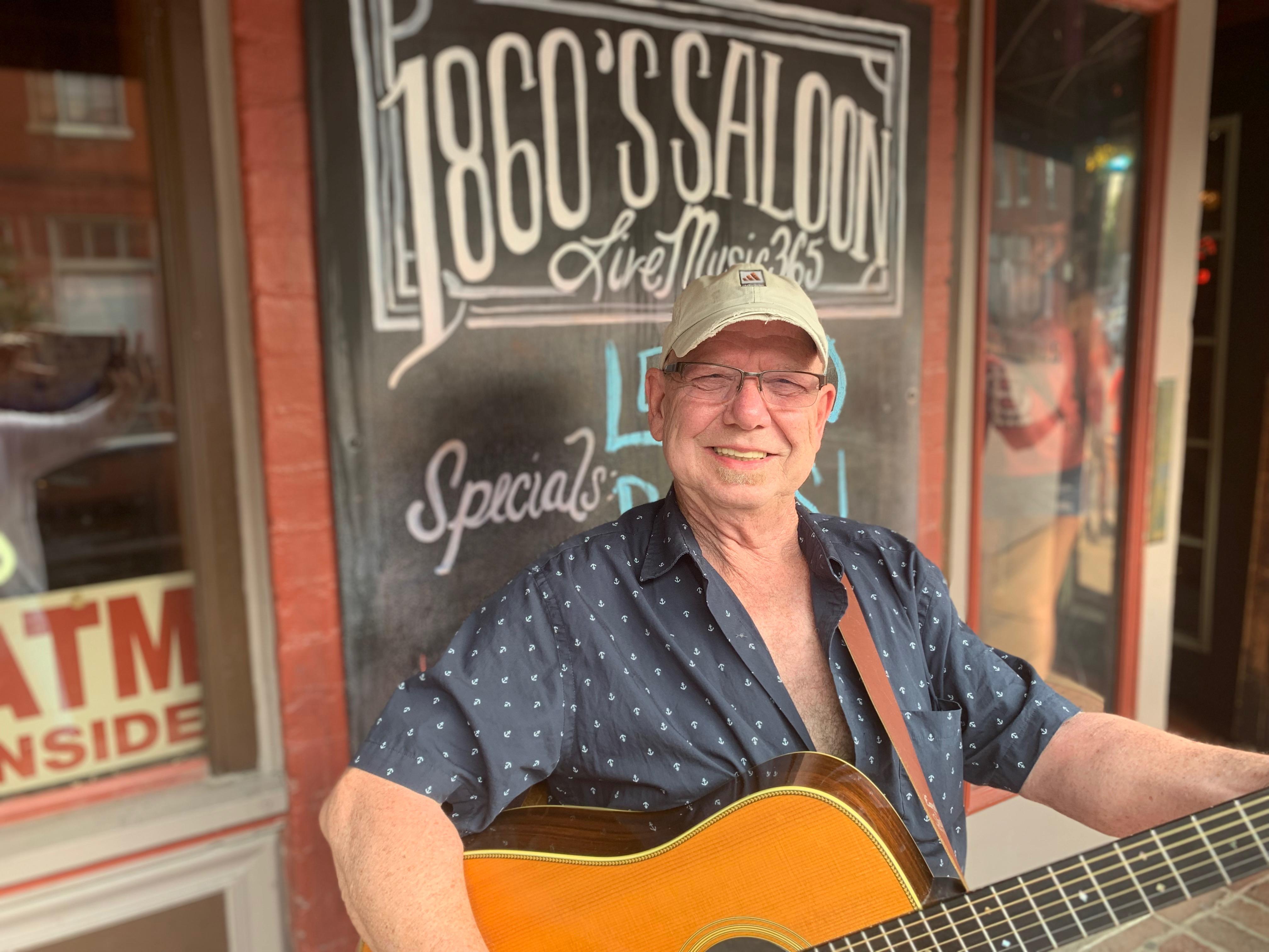 Rick Green plays acoustic guitar at 1860 Saloon