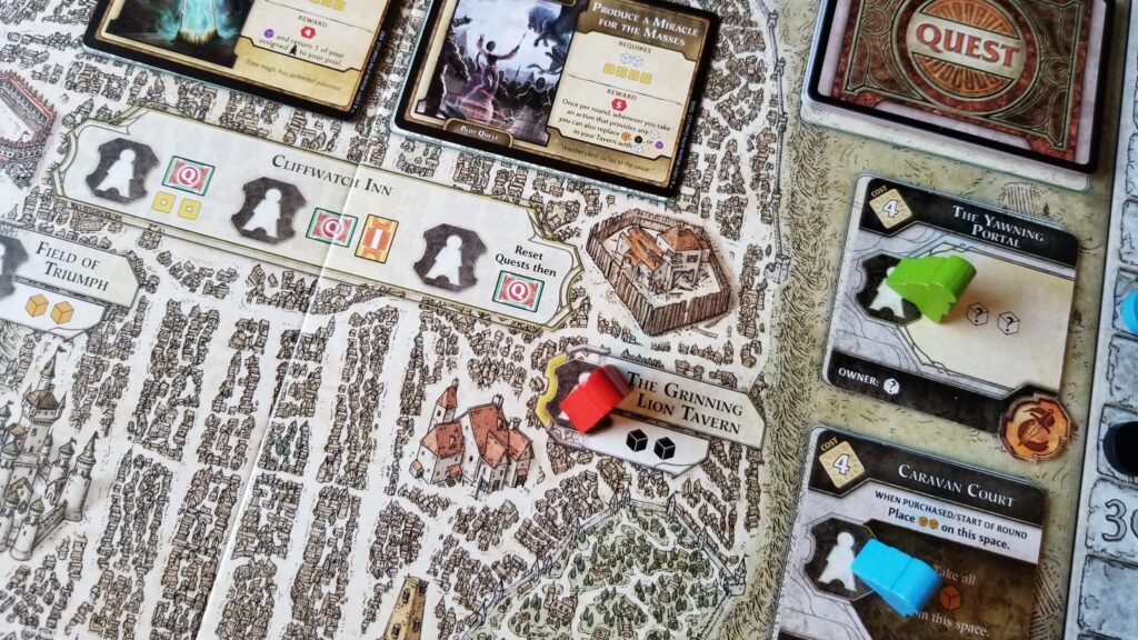 The game board depicts a map of Waterdeep with craggy, medieval streets and buildings