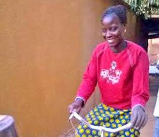 As a part of the Women's Aid Fund, Elizabeth is now able to happily ride a bicycle with the use of her prosthetic arm