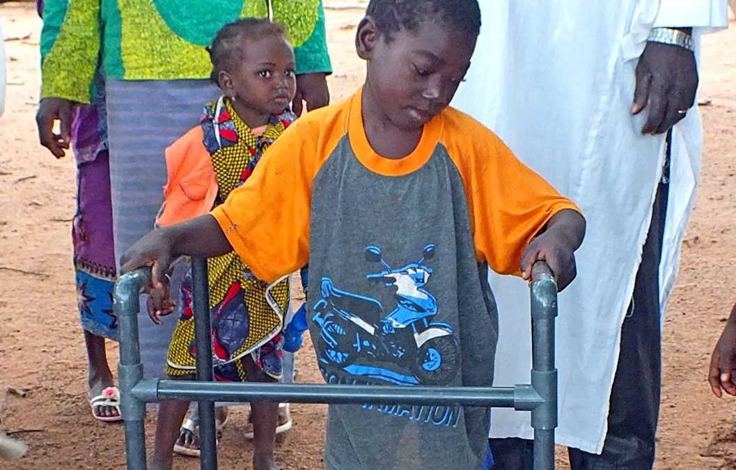 Yaya was not able to walk without assistance until a missionary build him a walker out of PVC pipe.