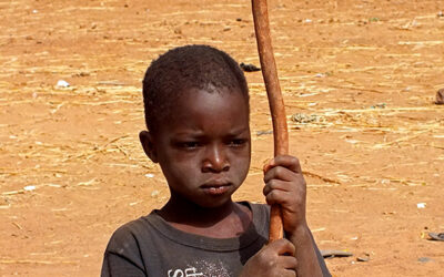 Life in African villages.  Even the youngest have work to do.