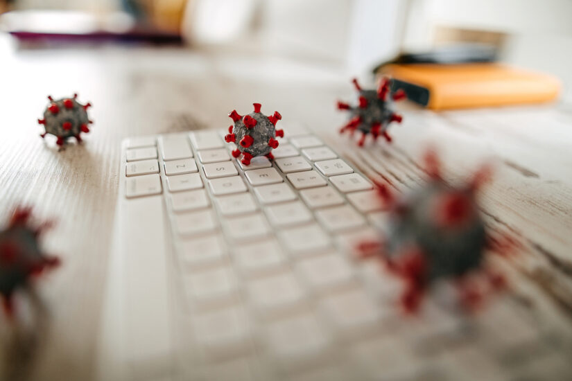 covid-19_coronavirus_morphology_infection_outbreak_pandemic_viral_cells_scattered_across_keyboard_and_workspace_by_mixetto_gettyimages-1215023248_2400x1600-100854873-large.jpg