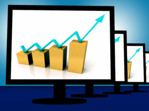 Arrow Going Up On Monitors Shows Financial Growth And Success