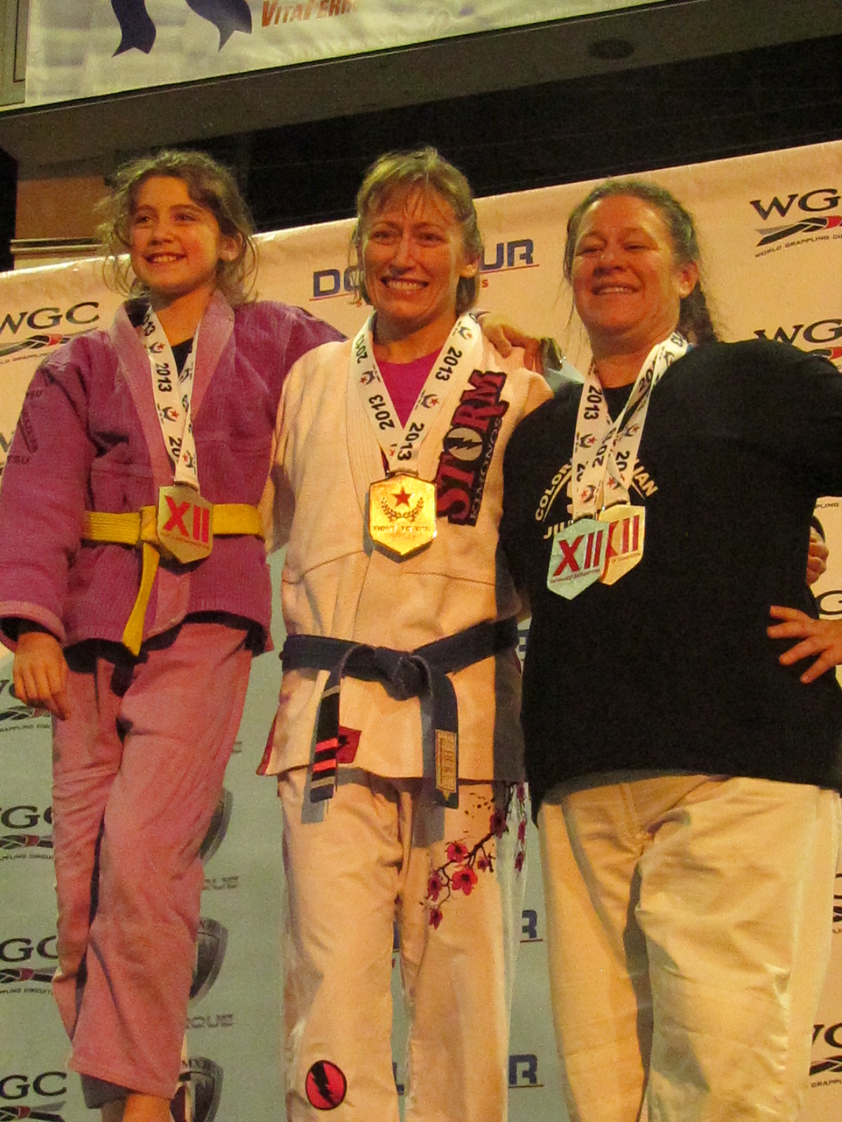 CBJJ Stapleton Ladies on the Medal Stand - 2013 Fight To Win Tournament of Champions 12 - Kate Stewart (Gold) - Teri Stewart (Gold) - Heather Westman (Silver & Bronze)