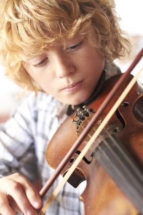 Boy Practicing Violin At Home