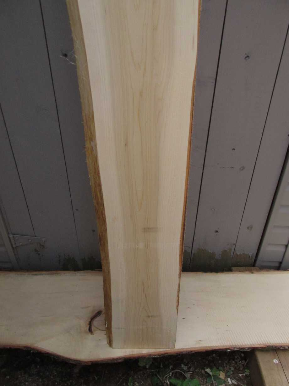 closeup of bottom grain - Cedar wood live edge slab for sale 10 wide by 96 inches long
