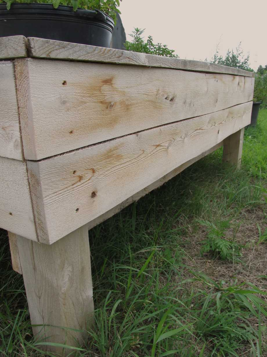 Side view of solid cedar wood planter box made from hand milled Ontario cedar. Planter has two compartments and is ideal for backyard or balcony.