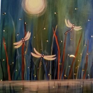 Dragonflies on water