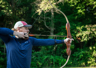 man holding bow and arrow