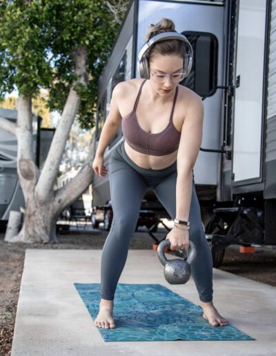 woman working out with kettlebell