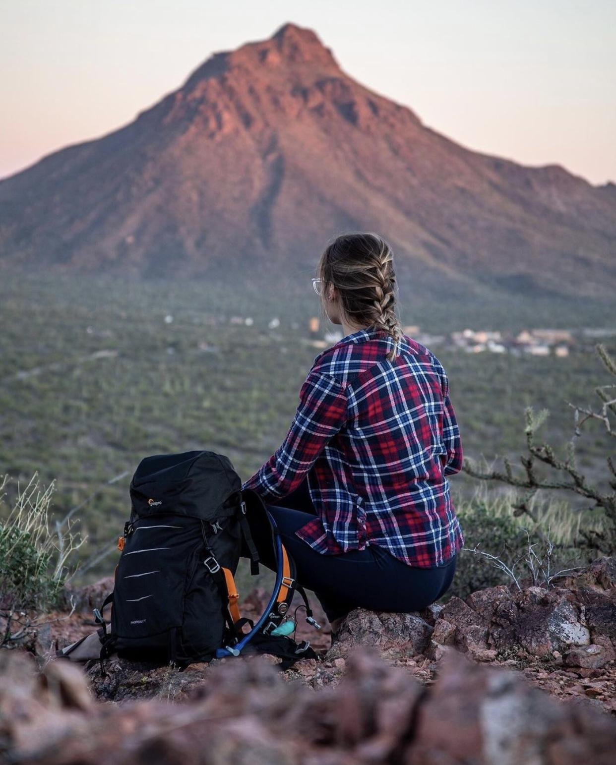 woman hiking next to mountain