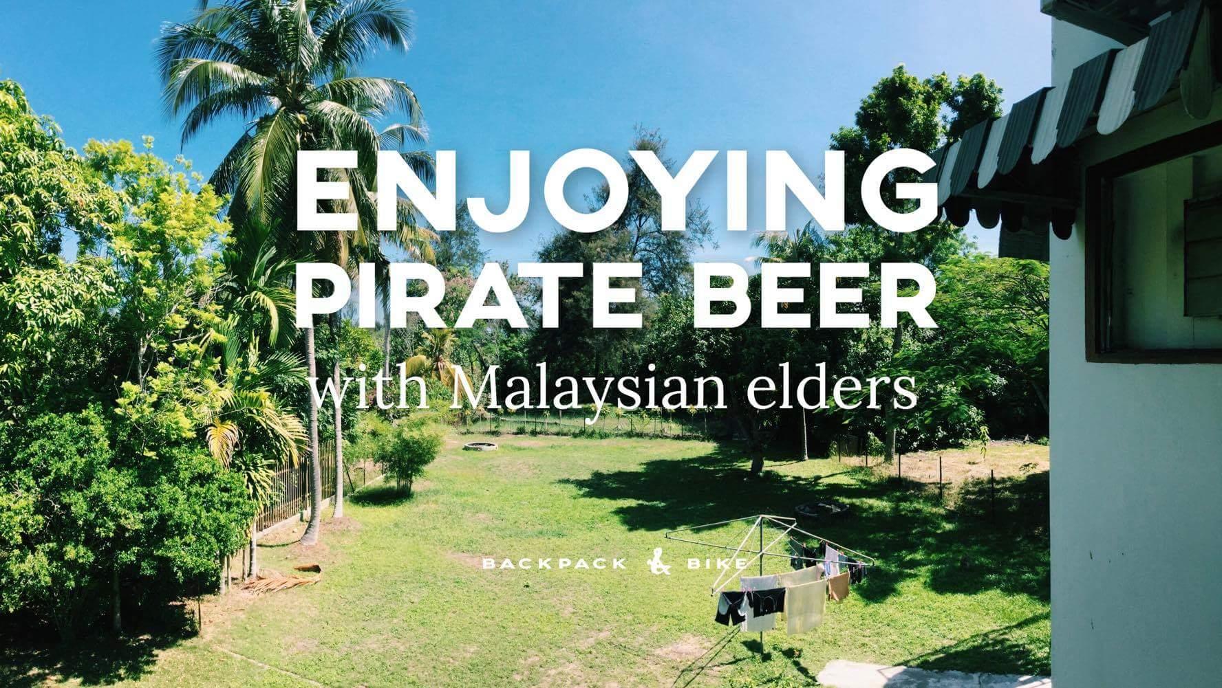 Enjoying Pirate Beer with Malaysian elders
