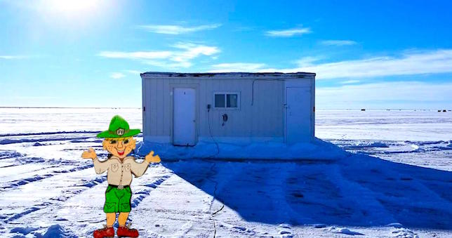 Parker stands in front of a Red Lake ice shack