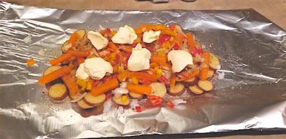 Potato, carrot, onion and pepper mixture topped with margarine
