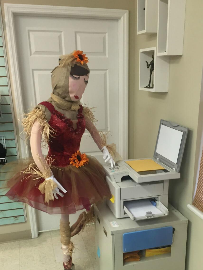 Scarecrow using the copier