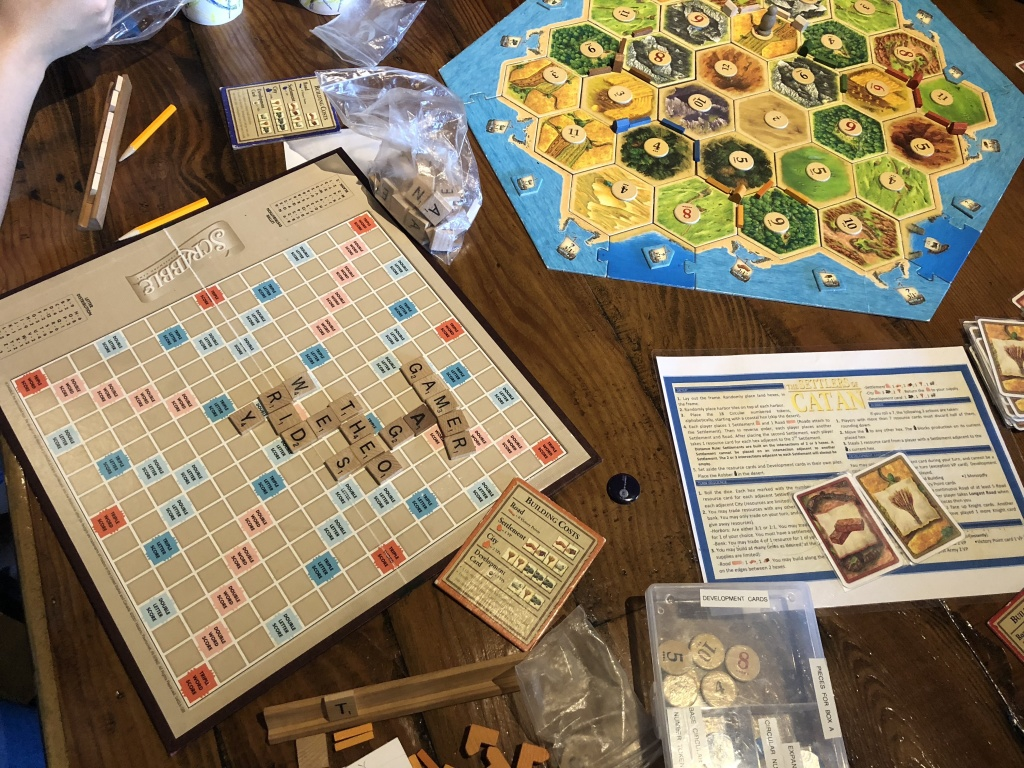 After finishing Monopoly, Yeon Kim, Mark Yang, and their friends moved on to Catan, but their secondary game Scrabble is still going strong