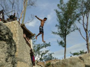 My son, jumping of the cliff's at Rick's Cafe
