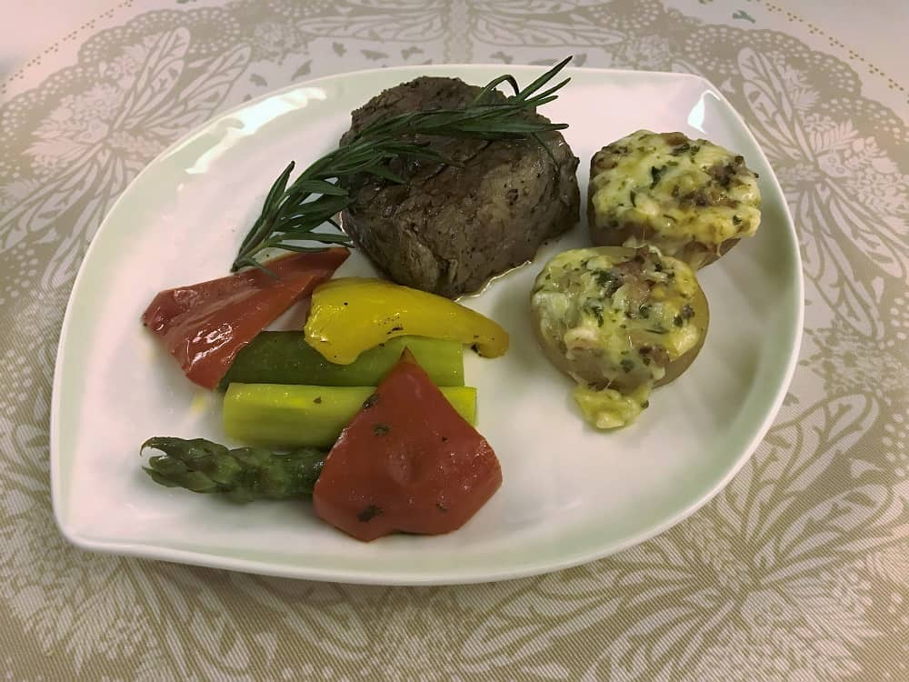Main course filet mignon while flying