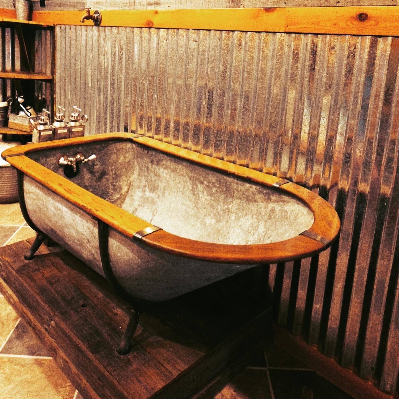 rustic tub in glowing embers room