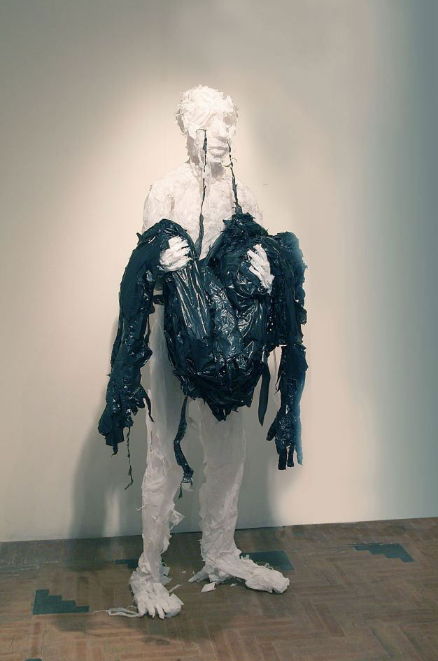 """""""Collector,"""" black and white trash bags"""
