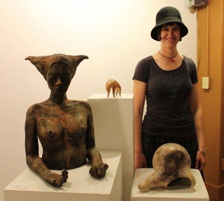 Eva-standing-next-sculptures
