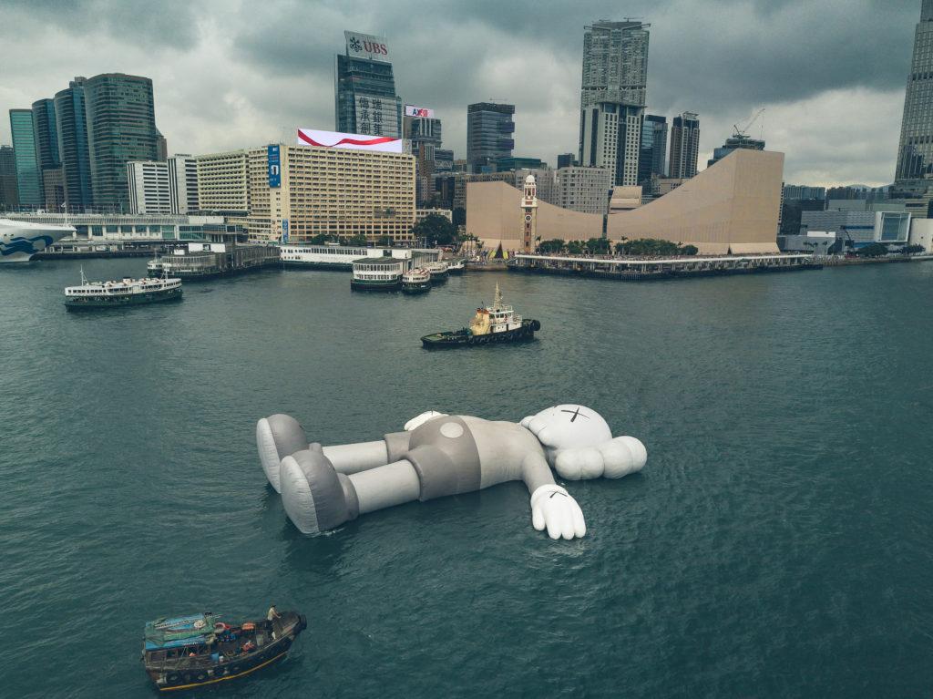 KAWS' sculpture 'Companion' floats in Victoria Harbor in Hong Kong on March 22, 2019. KAWS' sculpture 'Companion' floats in Victoria Harbor in Hong Kong on March 22, 2019. Photo: Harimao Lee