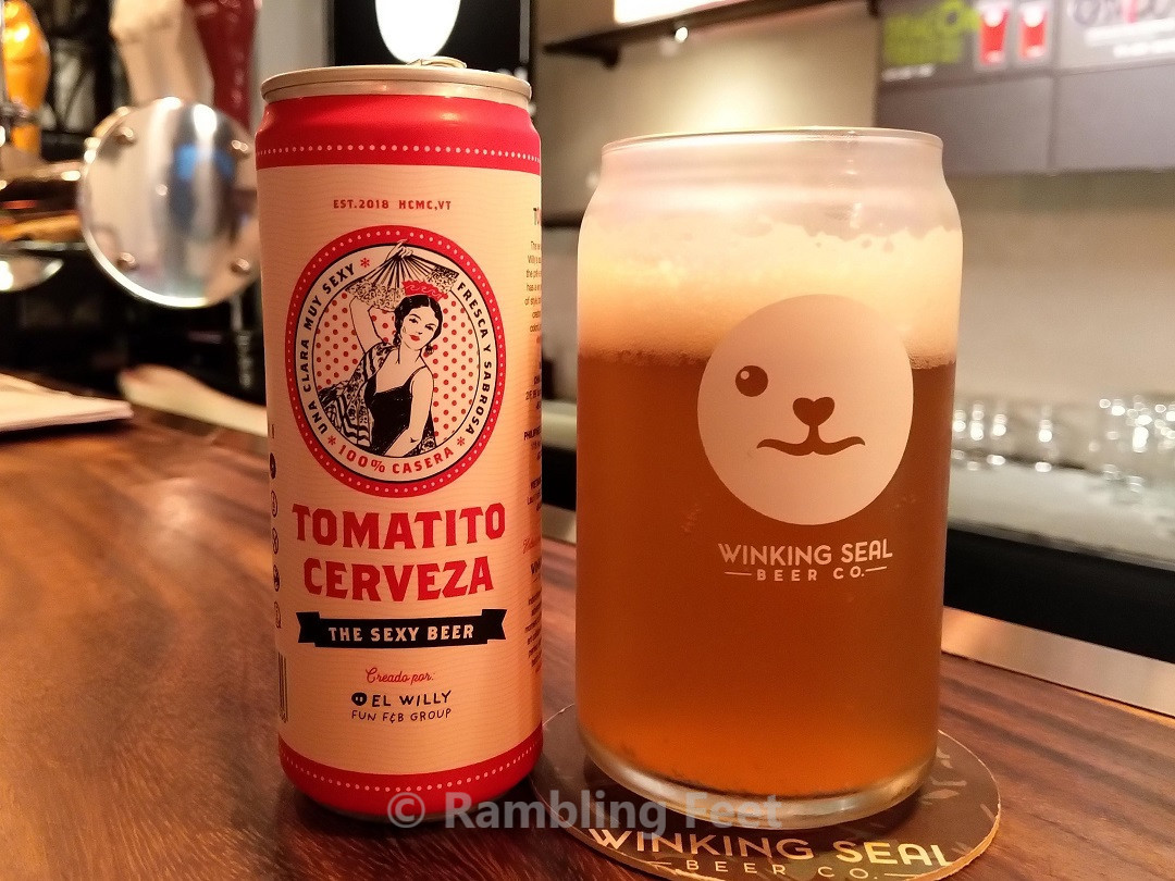 Winking Seal beer can and glass