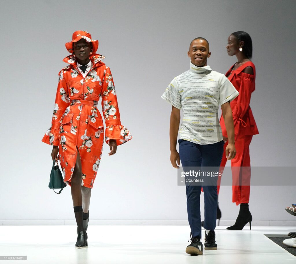 Designer Thebe Magugu (left) takes a bow during the Thebe Magugu Show on Day One of South Africa Fashion Week 2019.