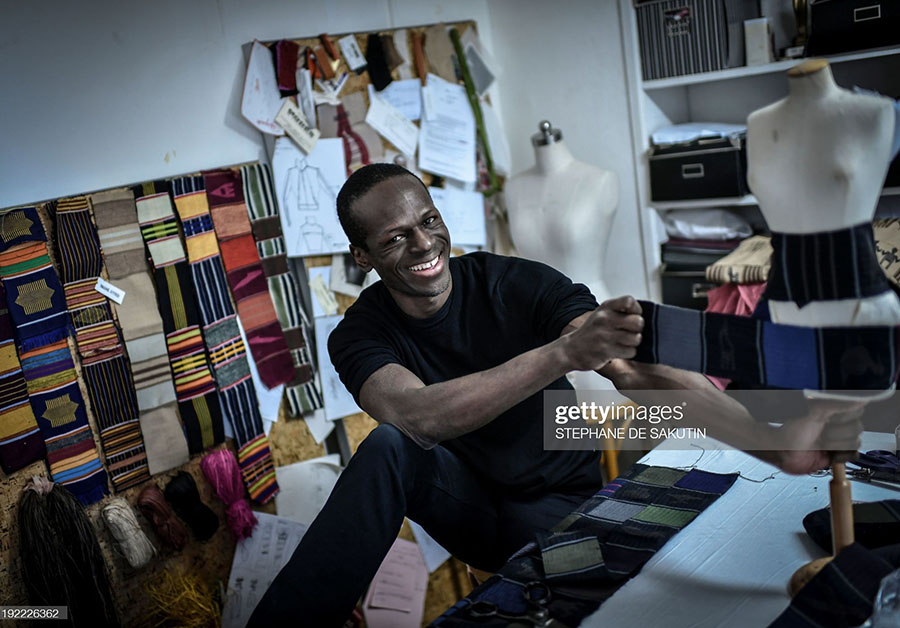 Cameroonian fashion designer Imane Ayissi, poses during a photo session, on January 6, 2020, at his workshop in Paris.