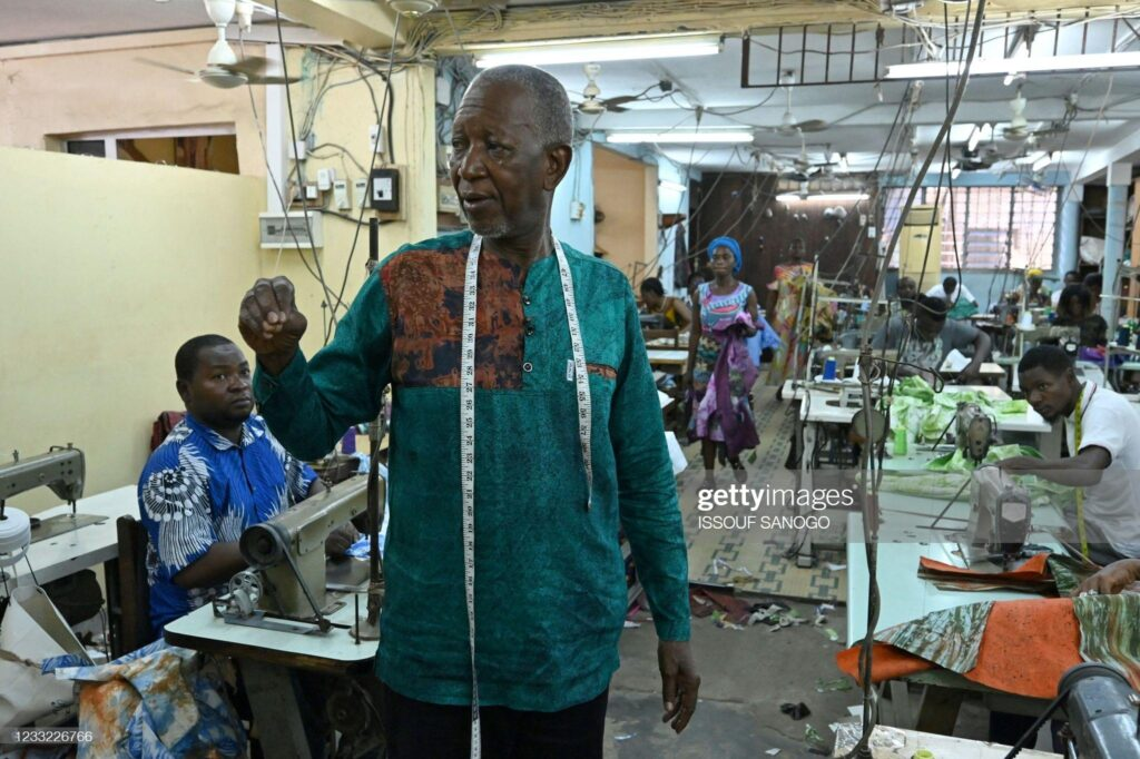 Ivorian-Burkinabe fashion designer Pathé Ouedraogo, known as Pathé'O, poses for a photograph in his store in Abidjan on May 26, 2021.