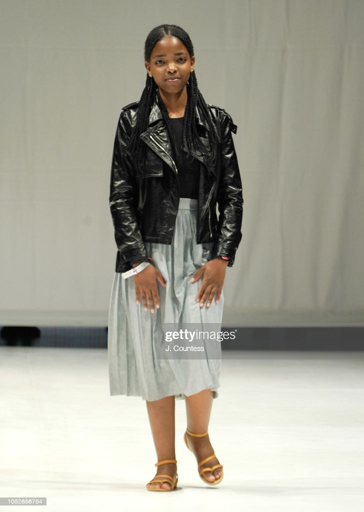Designer Fikile Zamagcino Sokhulo walks the runway in Fikile Sokhulo fashion during the autumn/winter 2019 collections at South Africa Fashion Week at Sandton City Mall on October 23, 2018 in Johannesburg, South Africa.