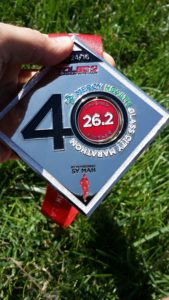 2016 glass city marathon finisher's medal -- achieving millennial