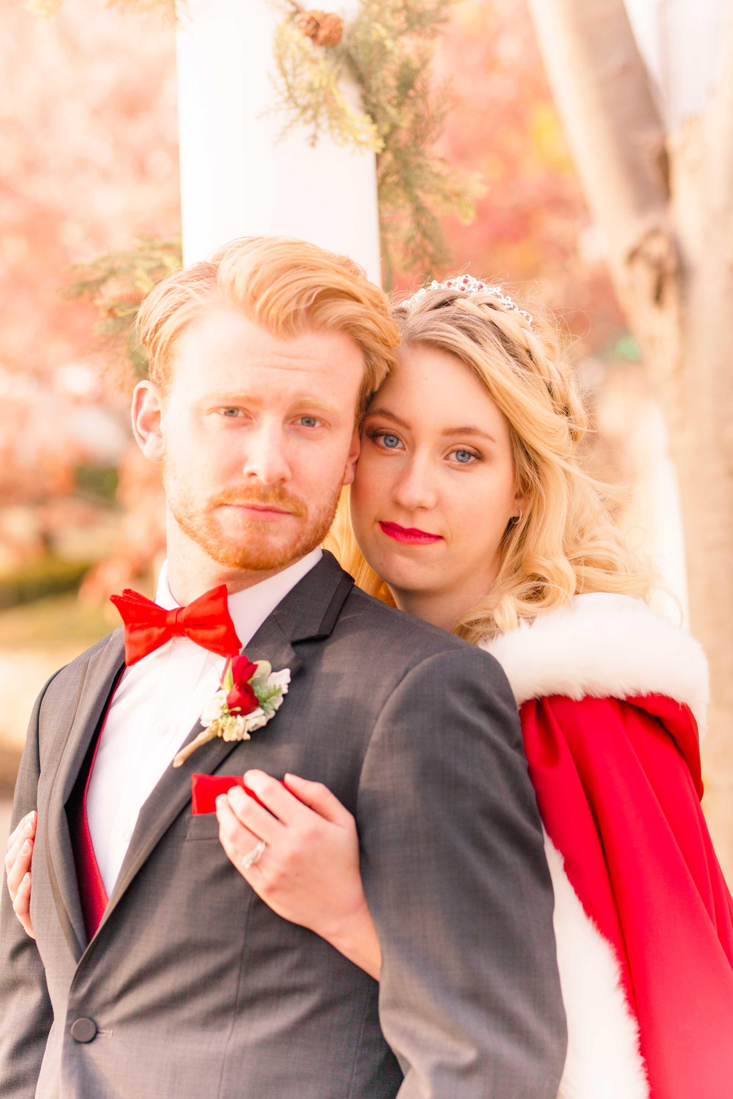 winter wedding couple embrace